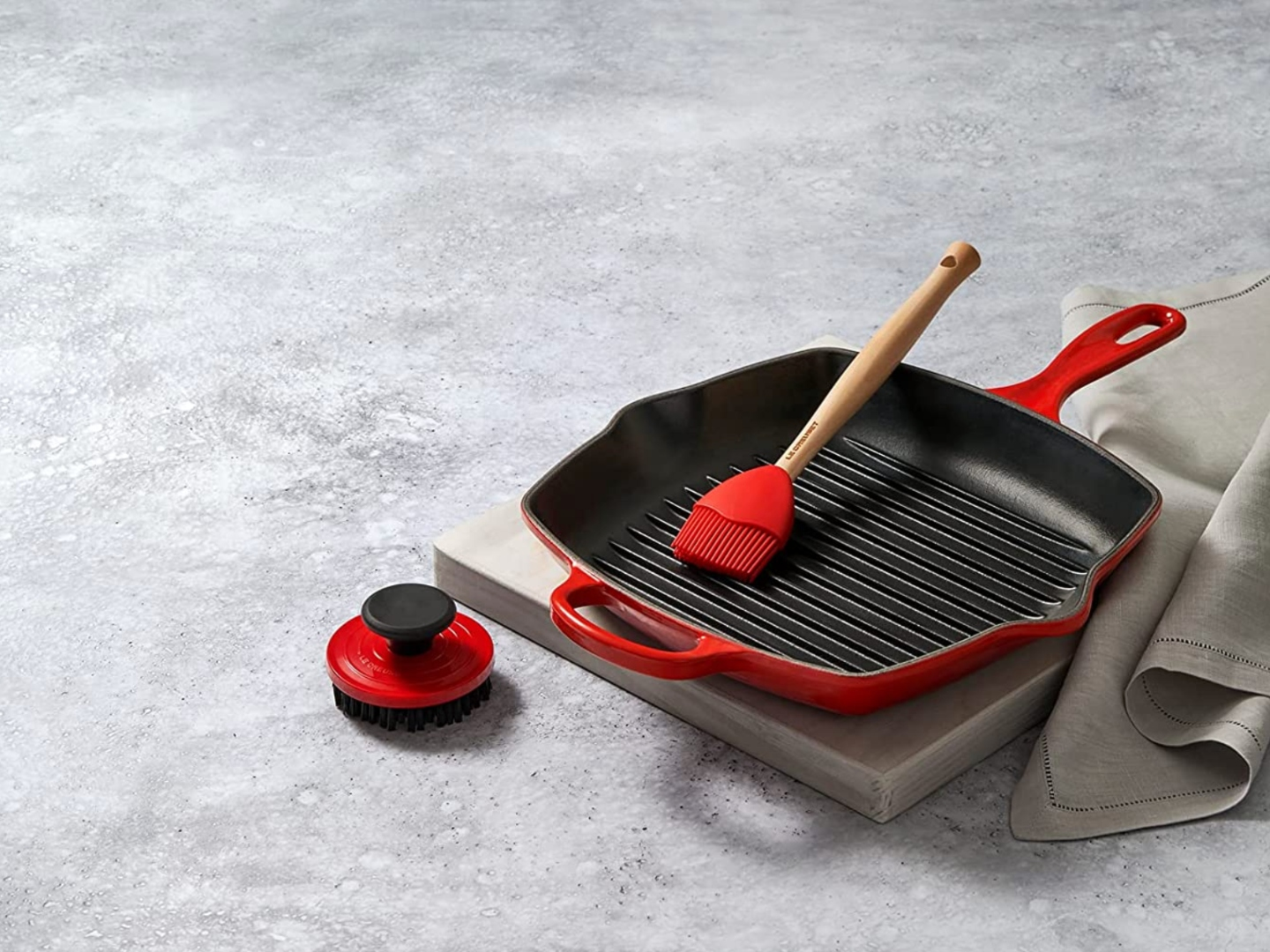 Le Creuset Makes a Game-Changing Brush For Effortless Grilling Clean-Up